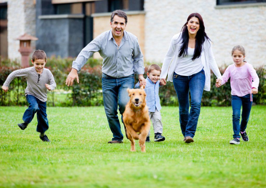 Heartfelt Budgeting Photo of family having fun outdoors