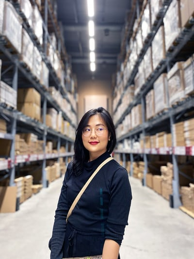 Business Owner With Warehouse Inventory